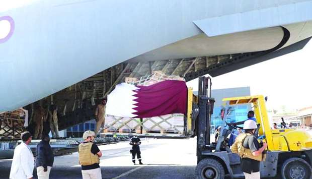 Aid materials being unloaded from a Qatar aid plane at Mogadishu
