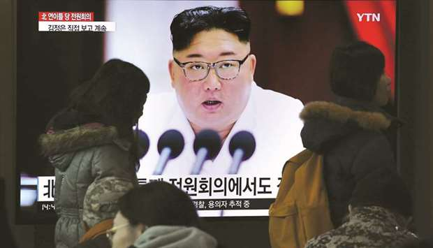 People watch a television news programme showing the latest pictures of North Korean leader Kim Jong