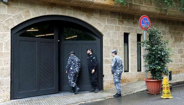 Lebanese police officers are seen at the entrance to the garage of what is believed to be former Nis