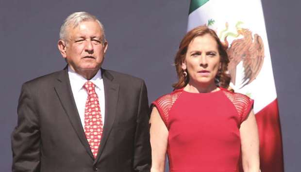 Mexican President Andres Manuel Lopez Obrador, accompanied by his wife, Beatriz Gutierrez Muller, at