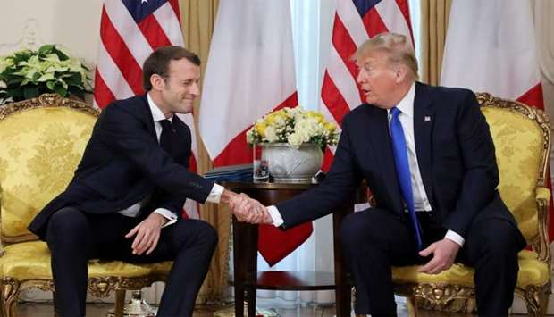 US President Donald Trump and France's President Emmanuel Macron shake hands during their meeting at