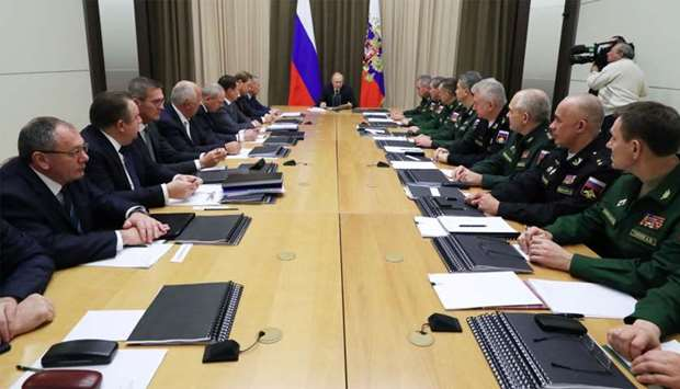 Russian President Vladimir Putin chairs a meeting with top officials of the Russian Defence Ministry
