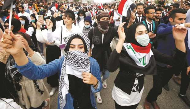 University and college students attend the ongoing anti-government protests in Basra, yesterday.