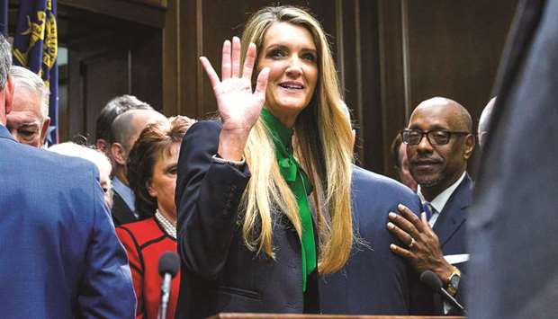 Newly appointed senator Kelly Loeffler waves toward supporters following a press conference in the g