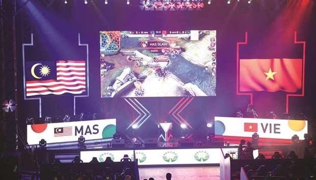 Gamers from Malaysia (left) and Vietnam (right) compete in the qualifying rounds of the eSports even