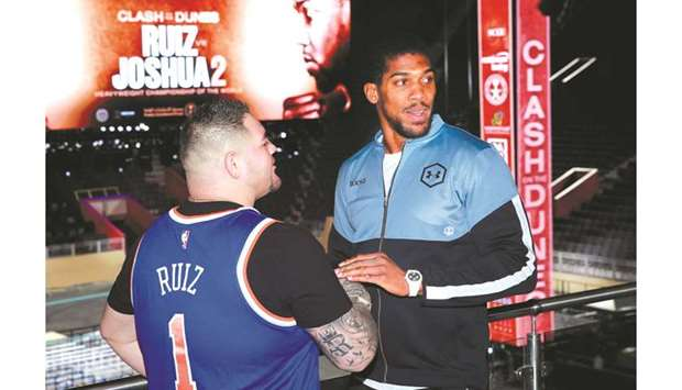 Andy Ruiz Jr and Anthony Joshua pose after the press conference ahead of their bout tomorrow. (Reute