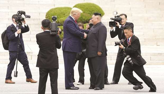 US President Donald Trump meets with North Korean leader Kim Jong-un at the demilitarised zone separ