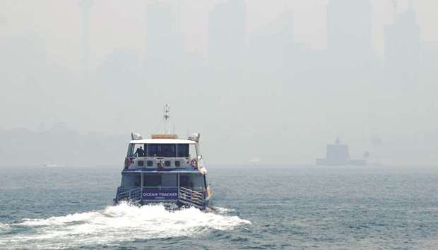 A ferry makes its way from Taronga Zoo to Circular Quay, with the CBD skyline barely visible in the