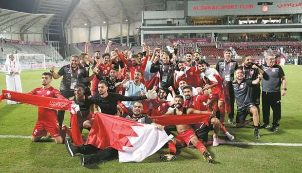 Bahrain players celebrate their win in the Gulf Cup semi-final against Iraq at Abdullah Bin Khalifa