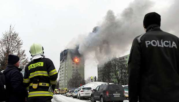 Smoke and fire emanate from an apartment building damaged by a gas explosion in Presov, Slovakia