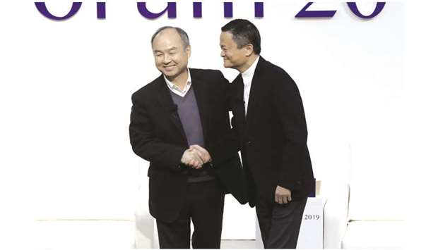 Masayoshi Son (left), and Jack Ma at Tokyo Forum yesterday. Son and Ma exchanged compliments and adv