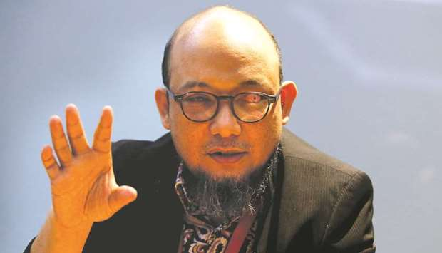 Novel Baswedan gestures as he talks during an interview at Corruption Eradication Commission (KPK) h