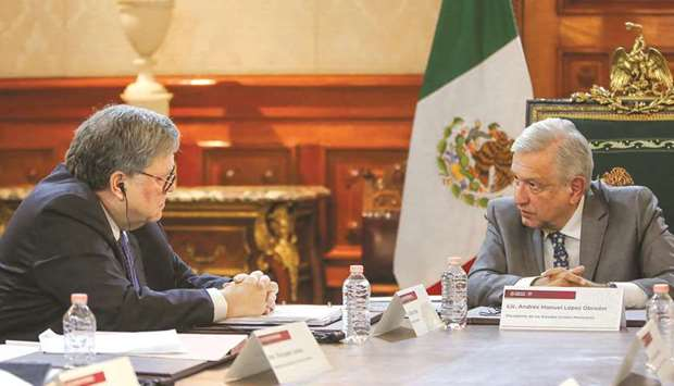 This handout photo released by the Mexican presidency shows Obrador with US Attorney-General Barr du
