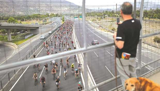 This picture taken last weekend shows demonstrators riding their bicycles in Santiago.
