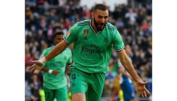 Real Madrid's Karim Benzema celebrates after scoring against Espanyol in Madrid. (AFP)