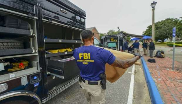 FBI Evidence Response Team after a shooting incident at a naval base in Pensacola, Florida.