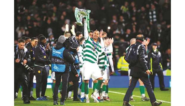 Celtic's Christopher Jullien (centre) celebrates winning the Scottish League Cup final with teammate