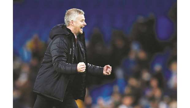 Manchester United manager Ole Gunnar Solskjaer celebrates his team's win over Manchester City at Eti