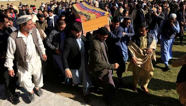 Afghan men carry the coffin of journalist Malalai Maiwand, who was shot and killed by unknown gunmen