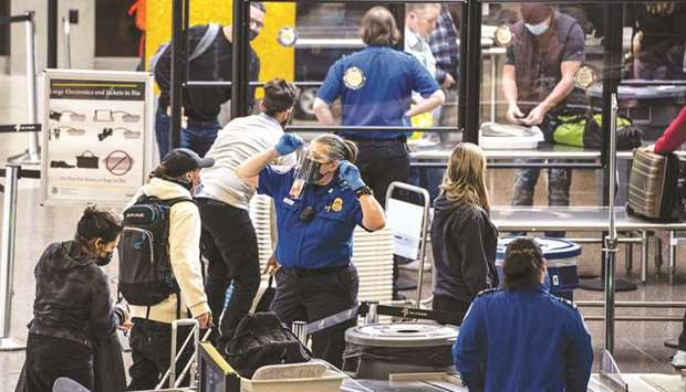 Travellers pass through security screening at Seattle-Tacoma International Airport in SeaTac, Washin