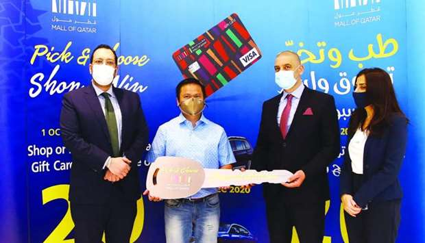 Mall of Qatar general manager Emile Sarkis hands over the ceremonial key to one of the winners, Ysma