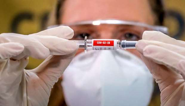 A nurse shows a Covid-19 vaccine produced by Chinese company Sinovac Biotech at the Sao Lucas Hospit