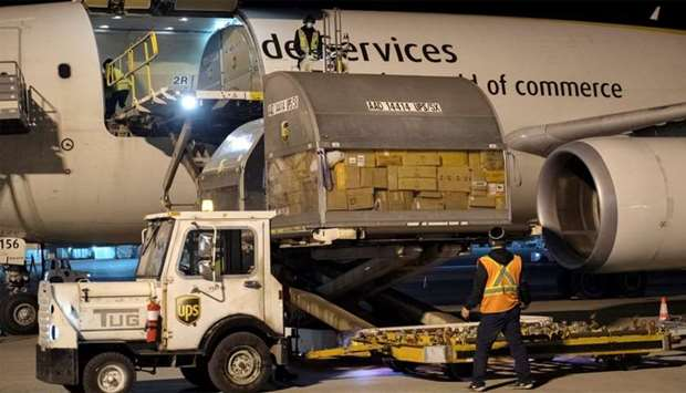 Canada's first batch of Pfizer/BioNTEch COVID-19 vaccines are unloaded from a UPS cargo plane at Mon