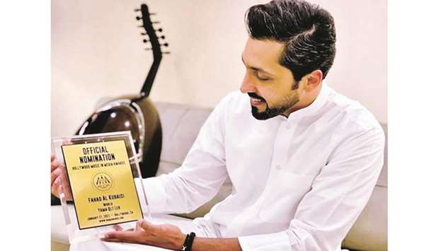 Fahad al-Kubaisi with the nomination plaque.