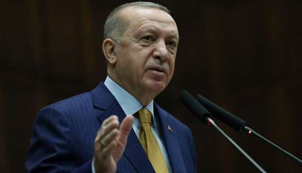 Turkish President Tayyip Erdogan addresses members of his ruling AK Party during a meeting at the pa