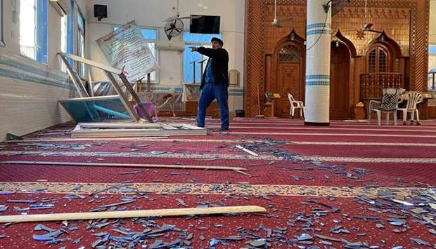 A Palestinian man inspects a mosque damaged in an Israeli air strike in Gaza City