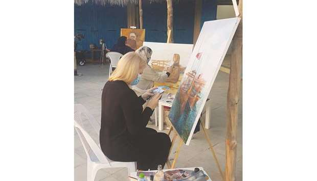 Russian artist Kristina al-Adwan paints her emblematic subject -- the dhow -- at the 10th edition of