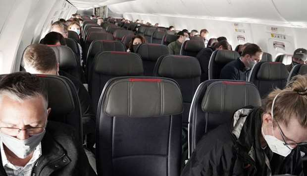 People fly on a media flight aboard a Boeing 737 Max airplane from Dallas Fort Worth Airport to Tuls