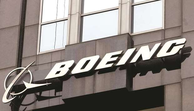 The Boeing signage is displayed on its building in Chicago. Boeing's debt totalled around $60bn as o