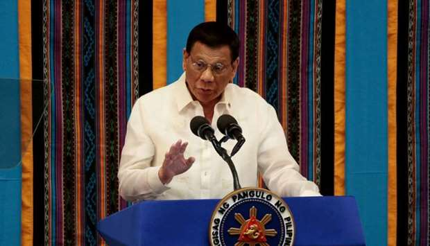 Philippine President Rodrigo Duterte gestures during his fourth State of the Nation address at the P