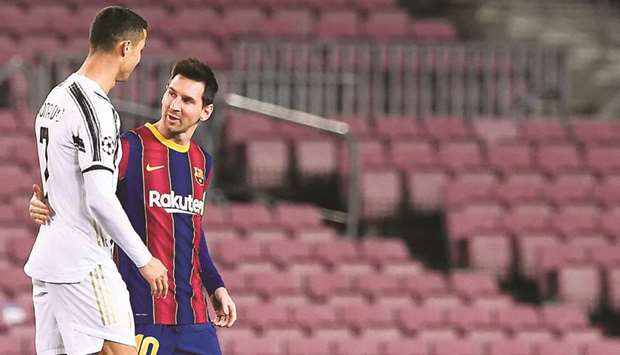 Juventus' Cristiano Ronaldo (left) greets Barcelona's forward Lionel Messi before the UEFA Champions