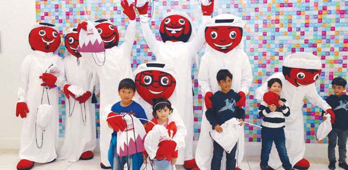 Ooredoo's Alrabaa seen with children during Qatar National Day celebrations.