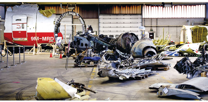 Debris from Malaysia Airlines flight MH17 laid out in a hangar on Gilze-Rijen airbase.