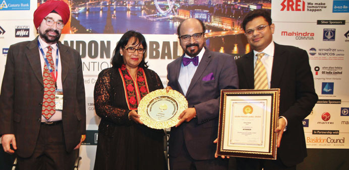 Seetharaman receiving the Golden Peacock Award from Baroness Verma in London.