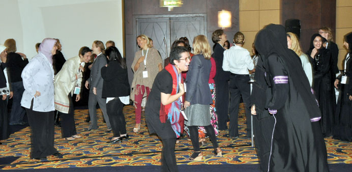 * Laughter Yoga teacher Gabi Pezo conducts a session at HWW conference 2012.
