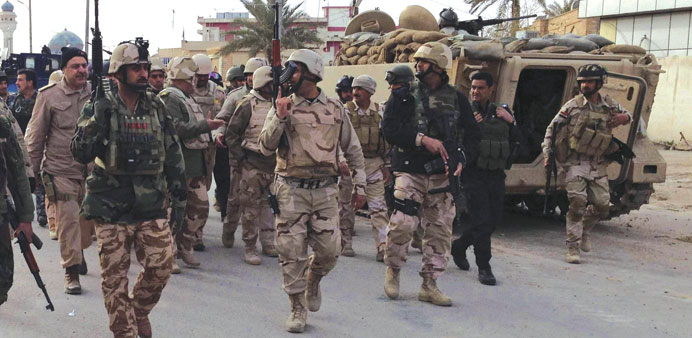 Iraqi soldiers deploy on the outskirts of Anbar province yesterday.