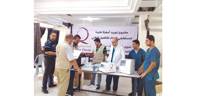 QC officials handing over some of the donated equipment.