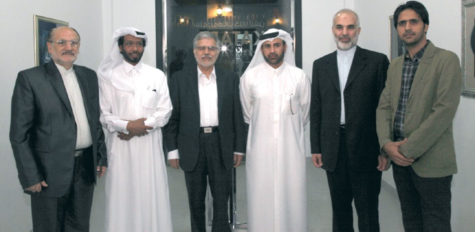 Dr al-Sulaiti (third right) with the Iranian officials and the artist.