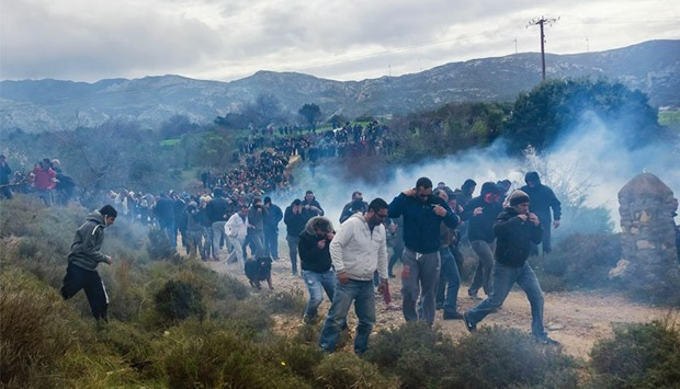 "Tear gas is fired as people protest against the so-called ""hotspot"", island of Kos"