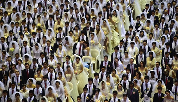 Couples attend a mass wedding in South Korea