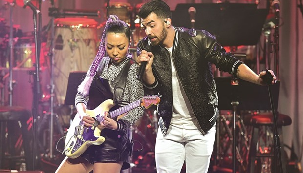 Singer Joe Jonas and JinJoo Lee of DNCE perform late on Saturday during the annual Clive Davis pre-G