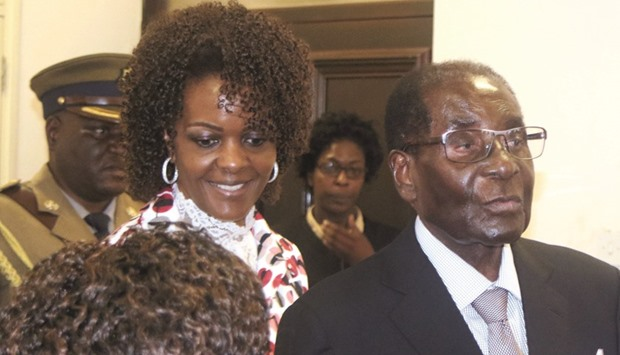 President Robert Mugabe and his wife Grace arrive to chair ZANU PF's Politburo meeting at the party