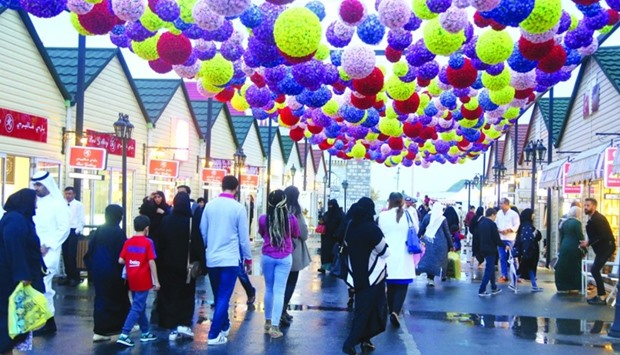 Colourful 'flower balls' at the Magical Festival Village brighten up the rainy weather. PICTURES: Ja