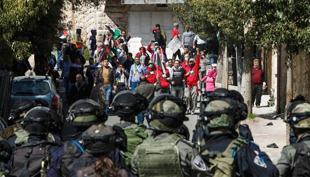 Israeli security forces clash with Palestinian and foreign protesters