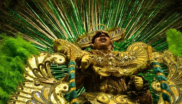 A dancer of the Unidos de Vila Maria samba school performs