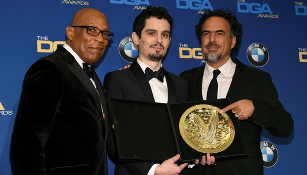 "Damien Chazelle (C), winner of the Feature Film Award for his work on ""La La Land"""